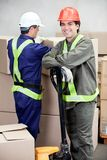 Foreman With Colleague Working At Warehouse Royalty Free Stock Photography