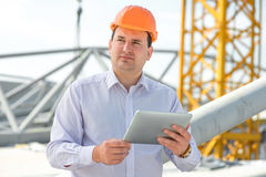 A foreman at the construction. A foreman with digital tablet at the construction supervising the project stock images