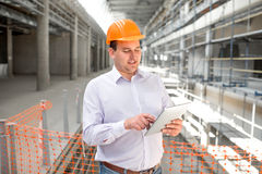 A foreman at the construction. A foreman with digital tablet supervising the project at the construction stock photo