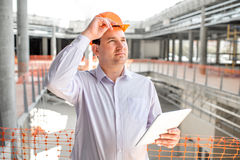 A foreman at the construction. A foreman with digital tablet supervising the project at the construction stock images
