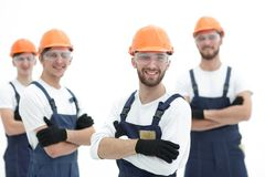 Foreman and construction team on white. Photo with copy space stock photo