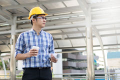 Foreman construction worker holding blueprint Stock Images