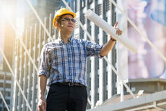Foreman construction worker holding blueprint. Man royalty free stock photography