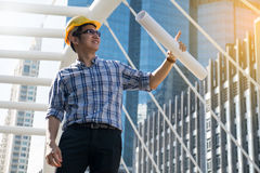 Foreman construction worker holding blueprint. Man stock image
