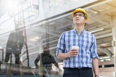 Foreman construction worker holding blueprint Stock Image