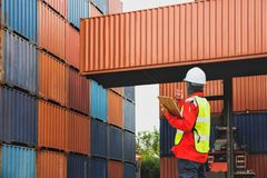Foreman control loading Containers stock photography