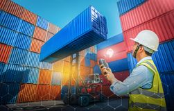 Foreman control loading containers box from cargo freight ship for import export, Foreman control industrial container cargo stock images