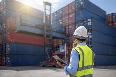 Foreman control loading Containers box Royalty Free Stock Photos
