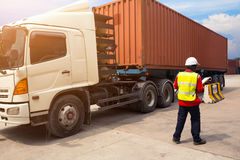 Foreman control loading Containers box to truck for Logistic Import Export background Stock Images