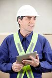 Foreman With Digital Tablet Standing in Warehouse Stock Photography