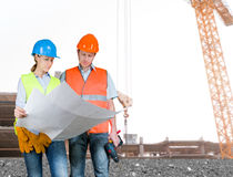 Foreman and engineer with blueprints Royalty Free Stock Photography