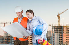 Foreman and engineer with blueprints Royalty Free Stock Image