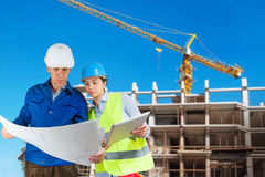 Foreman and engineer with blueprints Royalty Free Stock Photo