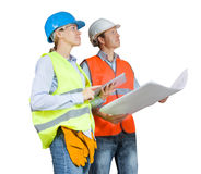 Foreman and engineer with blueprints Stock Image