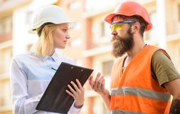 Foreman established supply of building materials. Expert and builder communicate about supply building materials. Construction industry. Successful deal royalty free stock photos