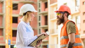 Foreman established supply of building materials. Expert and builder communicate about supply building materials. Successful deal concept. Purchase of building stock image