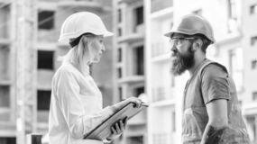 Foreman established supply of building materials. Expert and builder communicate about supply building materials stock image