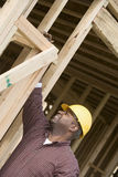 Foreman Examining Framework. Male foreman examining framework at construction site Royalty Free Stock Photography