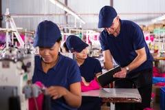 Foreman explaining machinist Stock Image