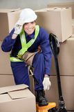 Foreman With Fork Pallet Truck At Warehouse Royalty Free Stock Image