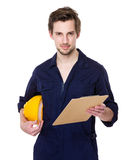 Foreman hold with clipboard and helmet Royalty Free Stock Photos