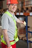 Foreman Holding Handtruck At Warehouse Stock Photography
