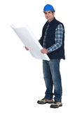 Foreman holding plans. Foreman holding his construction plans stock photography