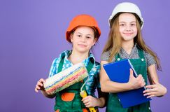 Foreman inspector. Repair. small girls repairing together in workshop. Labor day. 1 may. engineering idea. Little kids royalty free stock photos
