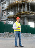 Foreman in jacket posing against building in scaffolding Royalty Free Stock Photography
