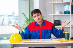 The foreman looking at construction plan. Foreman looking at construction plan royalty free stock photos