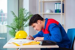 The foreman looking at construction plan. Foreman looking at construction plan stock photo