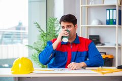 The foreman looking at construction plan. Foreman looking at construction plan royalty free stock image