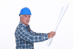 Foreman looking at plans. Grey haired foreman looking at plans Royalty Free Stock Image