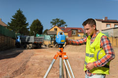 Foreman makes construction measurements at the beginning of the  work. Foreman makes construction measurements at the beginning of the construction work Stock Photos