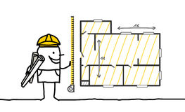 Foreman measuring a plan Royalty Free Stock Images
