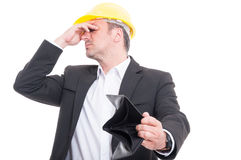 Foreman not looking at his empty wallet Royalty Free Stock Image
