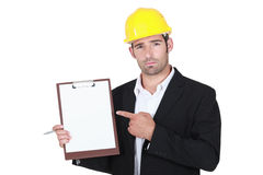 Foreman pointing at clipboard Stock Photography
