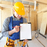 Foreman pointing at white folder Stock Images