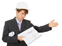 Foreman in protective helmet shows Stock Image