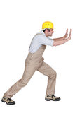 Foreman pushing against a wall Royalty Free Stock Photos