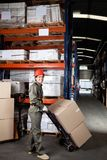 Foreman Pushing Handtruck With Cardboard Boxes Stock Photos