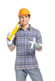 Foreman in range hard hat handing engineer's level Royalty Free Stock Image