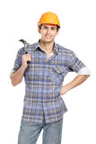 Foreman in range hard hat handing hammer Royalty Free Stock Photography