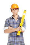 Foreman in range hard hat handing leveling instrument Royalty Free Stock Photos
