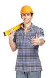 Foreman in range helmet handing engineer's level Royalty Free Stock Images