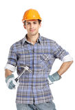 Foreman in range helmet handing hammer Royalty Free Stock Photo