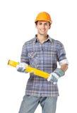 Foreman in range helmet handing level Stock Image