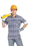Foreman in range helmet handing leveling instrument Stock Images