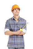 Foreman in range helmet handing tape measure Royalty Free Stock Photo