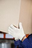 Foreman's Hands Lifting Cardboard Box Royalty Free Stock Images